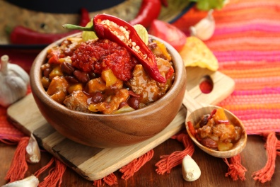 Chili Corn Carne - traditional mexican food, in wooden bowl,